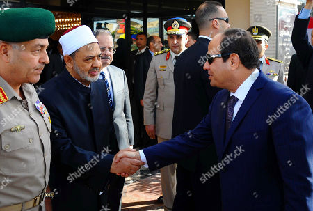 In this picture provided by the office of the Egyptian Presidency, Egyptian President Abdel-Fattah el-Sissi, right, shakes hands with Sheik Ahmed el-Tayeb, Grand Imam of Al-Azhar, outside the Field Marshal Hussein Tantawi Mosque in New Cairo, Egypt, . Muslims around the world celebrate Eid al-Adha, which commemorates the willingness of the prophet Ibrahim, or Abraham as he is known in the Bible, to sacrifice his son in accordance with God's will, though in the end God provides him a sheep to sacrifice instead