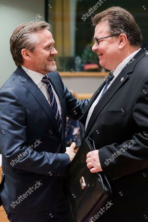 Denmark Foreign Minister Anders Samuelsen, left, greets Lithuania Foreign Minister Linas Antanas Linkevicius during an EU foreign ministers meeting at the EU Council in Brussels on