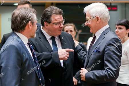 Poland Foreign Minister Jacek Czaputowicz, right, talks with Lithuania Foreign Minister Linas Antanas Linkevicius, center, and Denmark Foreign Minister Anders Samuelsen during an EU foreign ministers meeting at the EU Council in Brussels on