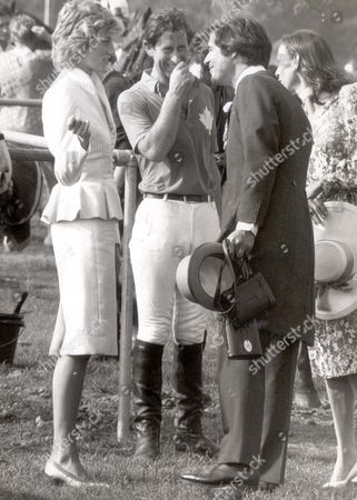 Stock Photo of Prince And Princess Diana 1986 - 17 June 1986 Princess Diana And Prince Charles With Oliver Hoare & his wife Diane At Guard's Polo....royalty