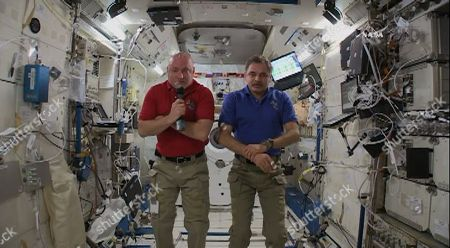 """This video screen grab taken from NASA, American astronaut Scott Kelly and Russian cosmonaut Mikhail Kornienko are interviewed at International Space Station on . Kelly and Kornienko told The Associated Press during the interview, that flight controllers have given up trying to command the cargo carrier. The unmanned vessel began tumbling shortly after its launch Tuesday from Kazakhstan. The cargo ship contains 3 tons of food, water, fuel, clothes and equipment for the six station residents. Kelly says everything and everyone on board should be OK, even without this shipment. But he says it's still unfortunate. Kornienko calls it """"a big concern"""
