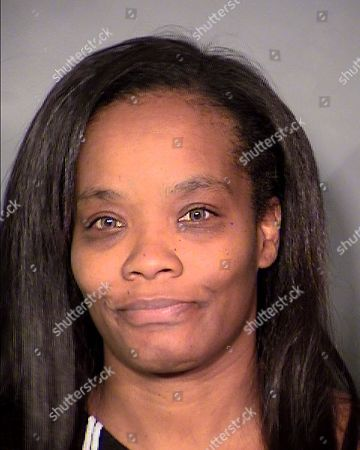 This undated booking photo released by Las Vegas Metropolitan Police Department shows Lavera Wilson. Las Vegas police say Bruce Oliver and Wilson accused of harboring murder suspect, Steven Lawrence Wright, who was mistakenly released from a Los Angeles jail in January 2016, are out on bond