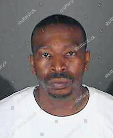Provided by the Los Angeles County Sheriff's Department shows inmate Steven Lawrence Wright. Wright, a murder suspect who authorities say was mistakenly released from a California jail, won't fight his transfer in custody from southern Nevada back to Los Angeles. Wright appeared in shackles and a red jail jumpsuit, and waived extradition in Henderson, Nev., Justice Court. He was arrested Monday in Boulder City, more than a week after police say he was released due to a paperwork mistake