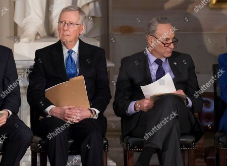 Mitch McConnell, Chuck Schumer. In this photo from, Senate Majority Leader Mitch McConnell, R-Ky., left, and Senate Minority Leader Chuck Schumer, D-N.Y., sit together to honor former Sen. Bob Dole, at the Capitol in Washington, Wednesday, Jan. 17, 2018. Schumer, arguably the most powerful Democrat in Washington, is trying to keep his party together to force a spending bill that would include protections for young immigrants, even as the federal government shutdown enters a third day