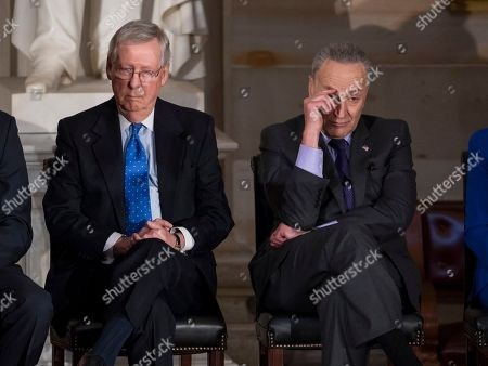Mitch McConnell, Chuck Schumer. In this photo from, Senate Majority Leader Mitch McConnell, R-Ky., left, and Senate Minority Leader Chuck Schumer, D-N.Y., sit together to honor former Sen. Bob Dole, at the Capitol in Washington, Wednesday, Jan. 17, 2018
