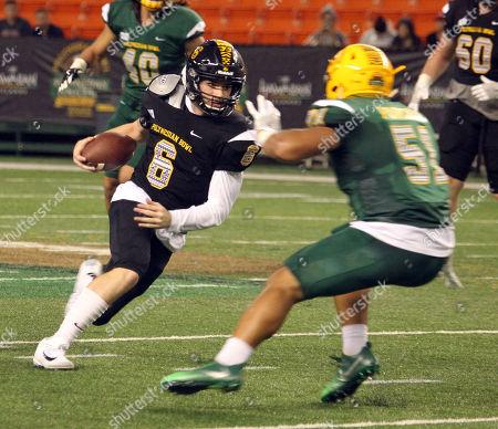 Team Makai quarterback Devin Leary #6 (Timber Creek HS / NC State commit) runs during the Polynesian Bowl high school football showcase at Aloha Stadium in Honolulu, Hawaii - Michael Sullivan/CSM