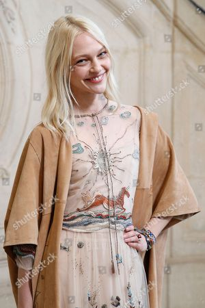 Russian model Sasha Pivovarova poses during a photocall before Christian Dior Haute Couture Spring-Summer 2018 fashion collection presented in Paris