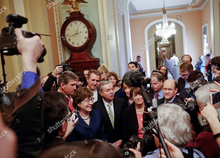 Lindsey Graham, Joe Manchin, Susan Collins, Jeff Flake, Lisa Murkowski, Maggie Hassan, Chris Coons. Sen. Lindsey Graham, R-S.C., center, speaks to members of the media outside the Senate Chamber on Capitol Hill in Washington, . With Graham are from left, Sen. Joe Manchin, D-W.Va., Sen. Susan Collins, R-Maine, Sen. Jeff Flake, R-Ariz., Sen. Lisa Murkowski, R-Alaska, Sen. Maggie Hassan, D-N.H., and Sen. Chris Coons, D-Del