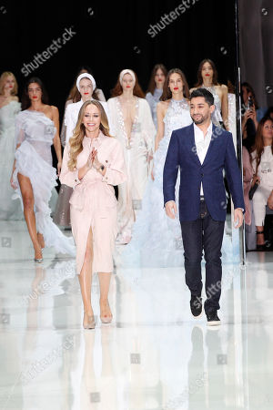 Tamara Ralph, Michael Russo. Designers Tamara Ralph, left, and Michael Russo accept applause at the end of the Ralph and Russo Haute Couture Spring-Summer 2018 fashion collection presented in Paris