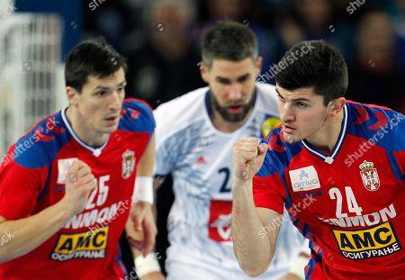 Stock Image of Serbia's Milan Jovanovic, right, celebrates his goal during the Eurohandball European Championships handball match between Serbia and France, in Zagreb, Croatia