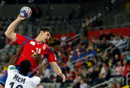 Stock Picture of Serbia's Milan Jovanovic, top, attempts to shoot during the Eurohandball European Championships handball match between Serbia and France, in Zagreb, Croatia