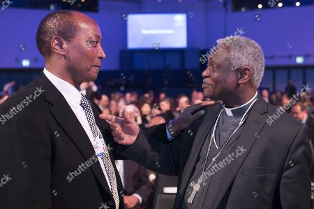 Cardinal Peter Kodwo Appiah Turkson, Prefect Dicastery for Promoting Integral Human Development (R), chats with entrepreneur Patrice Motsepe, during the Crystal Award Ceremony on the eve of the 48th annual meeting of the World Economic Forum, WEF, in Davos, Switzerland, 22 January 2018. The meeting brings together enterpreneurs, scientists, chief executive and political leaders in Davos January 23 to 26.