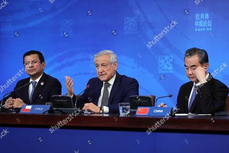 Heraldo Munoz, Hugo Martinez and Wang Yi