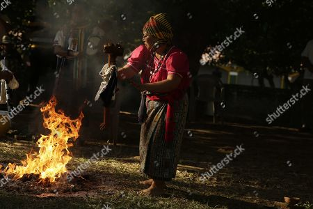 Members of the Salvadoran originary people participate in a ceremony in Izalco, El Salvador, 22 January 2018. The members of the originar peoples of El Salvador recalled the indigenous massacre of 1932 perpetrated by dictator Maximiliano Hernandez Martinez (1935-1944) and claimed for justice.