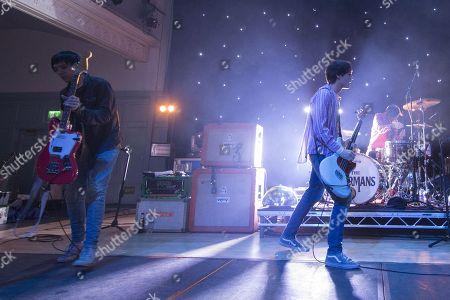 The Cribs - Ryan Jarman, Gary Jarman and Ross Jarman walk on to the stage