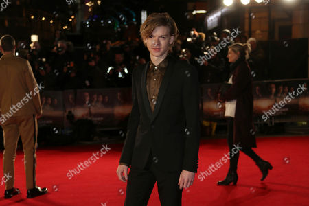Actor Thomas Brodie-Sangster poses for photographers upon arrival at the fan screening of the film 'Maze Runner: The Death Cure' in London