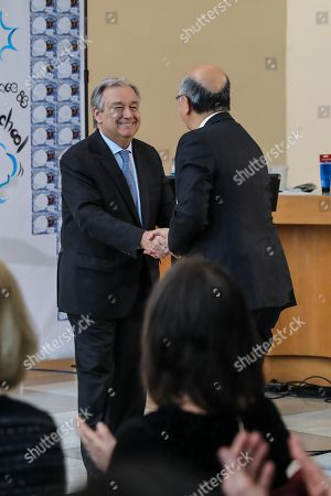"""UN Secretary-General Antonio Guterres (L) and Ambassador Koro Bessho, Permanent Representative of Japan to the UN are honored at the event """"Peace is"""" in the Lobby of the United Nations headquarters in New York"""