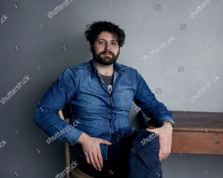 """Stock Image of Director Maxim Pozdorovkin poses for a portrait to promote the film """"Our New President"""" at the Music Lodge during the Sundance Film Festival, in Park City, Utah"""