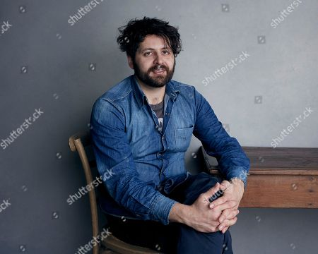 """Stock Photo of Director Maxim Pozdorovkin poses for a portrait to promote the film """"Our New President"""" at the Music Lodge during the Sundance Film Festival, in Park City, Utah"""