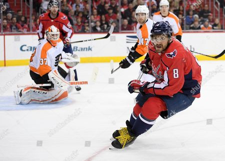 Washington Capitals left wing Alex Ovechkin (8), of Russia, skates during the second period of an NHL hockey game in front of Philadelphia Flyers goaltender Brian Elliott (37) and defenseman Andrew MacDonald (47), in Washington