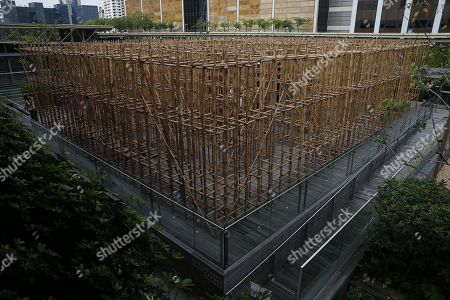 A general view shows the bamboo maze installation titled 'the infinite dimensions of smallness' by Thai artist Rirkrit Tiravanija on display on the roof garden at the National Gallery in Singapore, 23 January 2018. The installation consists of 2,500 bamboo poles arranged in a maze that spans over 285 square metres in area and four metres in height. It will be on display from 24 January to 28 October 2018 on the roof garden of the National Gallery in Singapore.