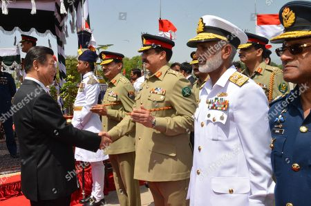 Xi Jinping, Raheel Sharif. Provided by Pakistan's Press Information Department, Chinese President Xi Jinping, left, shakes hands with Pakistan's army chief Gen. Raheel Sharif, at Nur Khan airbase in Islamabad, Pakistan. Pakistan, Afghanistan, China and the United States are meeting, in the Pakistani capital of Islamabad to craft out a roadmap for peace to end an increasingly bloody and protracted Afghan war. But warring sides are miles apart, say analysts and protagonists. The Taliban are not invited to Monday's talks