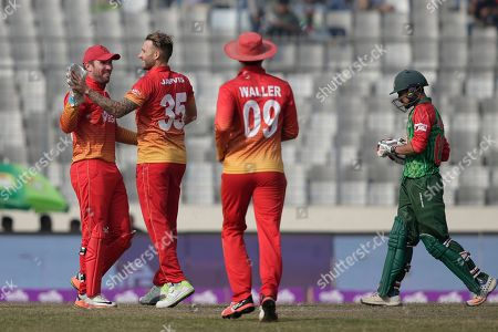 Kyle Jarvis, Nasir Hossain, Brendan Taylor. Zimbabwe's Kyle Jarvis, second left, celebrate with wicketkeeper Brendan Taylor, left, the dismissal of Bangladesh's Nasir Hossain, right, during the Tri-Nation one-day international cricket series in Dhaka, Bangladesh