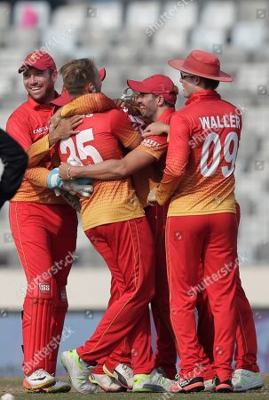 Stock Picture of Zimbabwe's players celebrate the dismissal of Bangladesh's Nasir Hossain during the Tri-Nation one-day international cricket series in Dhaka, Bangladesh
