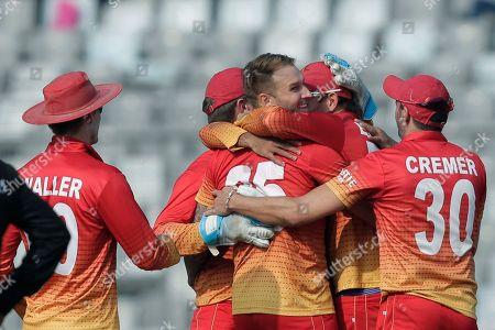 Zimbabwe's players celebrate the dismissal of Bangladesh's Nasir Hossain during the Tri-Nation one-day international cricket series in Dhaka, Bangladesh