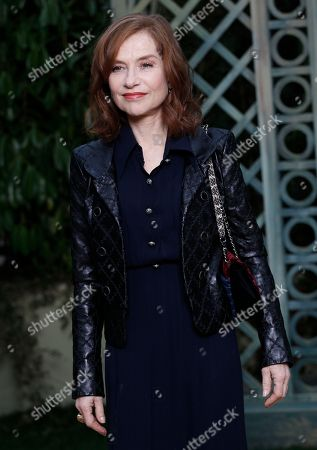 4ec2031b9ade95 French actress Isabelle Huppert poses during a photocall before Chanel  Haute Couture Spring-Summer 2018
