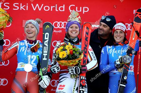 Germany's Viktoria Rebensburg, center, winner of an alpine ski, women's World Cup giant slalom, poses on the podium with, from left, second placed Norway's Ragnhild Mowinckel, Italian ski legend Alberto Tomba, 2nd from right, and third placed Italy's Federica Brignone, at the Kronplatz resort, in San Vigilio di Marebbe, Italy