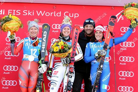 Winner Viktoria Rebensburg (C) of Germany with second placed Ragnhild Mowinckel (L) of Norway, third placed Federica Brignone (R) of Italy and Italian former ski racer Alberto Tomba (2-R) celebrate on the podium after the women's Giant Slalom race at the FIS Alpine Skiing World Cup event in Kronplatz, Italy, 23 January 2018.