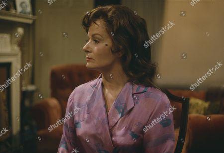 Margaret Lockwood, as Harriet Peterson