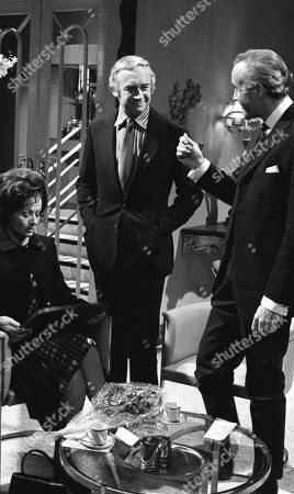 Margaret Lockwood, as Harriet Peterson and William Franklyn, as James Kirby; with Philip Latham, as Jardine