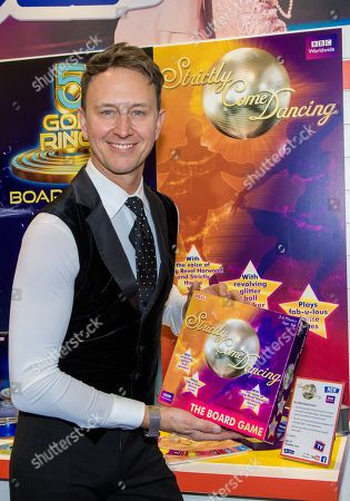 Former Strictly pro Ian Waite celebrates the unveiling of the first ever Strictly Come Dancing board game by John Adams at London's Toy Fair. The game launches Summer 2018.