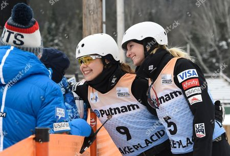 Ashley Caldwell, Kiley McKinnon. Ashley Caldwell (9) and teammate Kiley McKinnon (5), both of the United States, pose for photographs with fans, while training for the women's World Cup freestyle skiing aerials in Lake Placid, N.Y