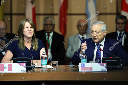 Chilean Foreign Minister, Heraldo Munoz (R), and his Peruvian counterpart, Cayetana Aljovin (L), take part at the meeting of the Lima Group in Santiago, Chile, 23 January 2018. Representatives of the Lima Group, Argentina, Brazil, Canada, Chile, Colombia, Costa Rica, Guatemala, Honduras, Mexico, Panama, Paraguay and Peru meet today in Santiago to analyze the situation in Venezuela, after the suspension of the dialogue between the Government and the opposition.