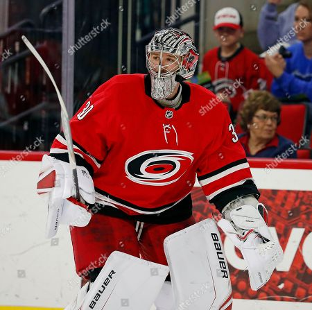 Carolina Hurricanes goaltender Cam Ward (30) skates to the net in relief of Scott Darling during the first period of an NHL hockey game against the Vegas Golden Knights, in Raleigh, N.C