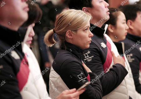 The South Korean women's hockey team head coach Sarah Murray, center, salutes during an inaugural ceremony for the 2018 Pyeongchang Winter Olympics, in Seoul, South Korea, . A 15-member North Korean women's ice hockey team consisting of 12 players, a coach and support staff was scheduled to arrive in South Korea on Thursday to begin training with South Korean athletes for a unified team that will compete at the Olympics