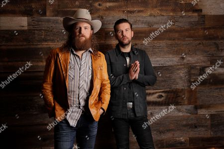 John Osborne, T J Osborne. John, left, and T. J. Osborne, of the group Brothers Osborne, pose in Nashville, Tenn. Since releasing their debut album in 2016, the Maryland-born brothers TJ and John Osborne have been racking up the country music awards and high profile appearances, including the 60th annual Grammy Awards this Sunday