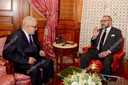 In this photo provided by the Royal Palace, Moroccan King Mohammed VI, right, chats with Moroccan head of the country's government Abdelilah Benkirane in Casablanca, Morocco, . Morocco's King Mohammed VI named leader of the Islamist Justice and Development Party, known as the PJD, Abdelilah Benkirane as prime minister for a second term after his party wining the most seats in last week's election