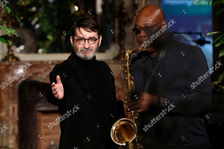 French fashion designer Franck Sorbier acknowledges applause after the presentation of Haute Couture Spring-Summer 2018 fashion collection, next to saxophonist Manu Dibango, in Paris, Wednesday, Jan.24, 2018