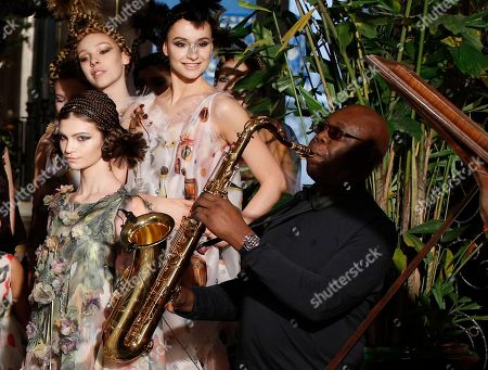Models present cretions for Franck Sorbier's Haute Couture Spring-Summer 2018 fashion collection while saxophonist Manu Dibango performs in Paris, Wednesday, Jan.24, 2018