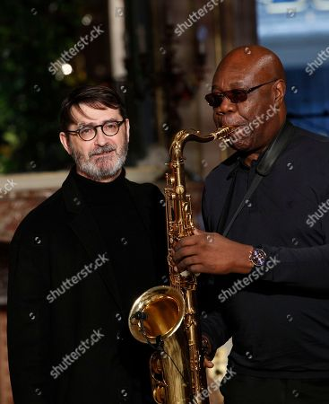French fashion Franck Sorbier poses with saxophonist Manu Dibango after his Haute Couture Spring-Summer 2018 fashion collection in Paris, Wednesday, Jan.24, 2018