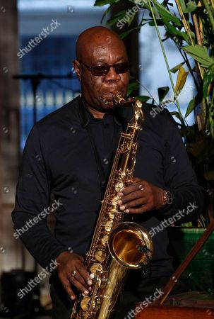 Saxophonist Manu Dibango, from Cameroon, performs during Franck Sorbier's Haute Couture Spring-Summer 2018 fashion collection in Paris, Wednesday, Jan.24, 2018
