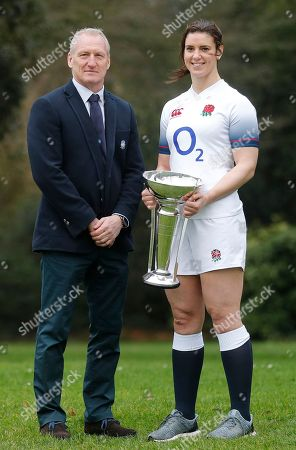 Stock Photo of The Rugby Women Team captain England's Sarah Hunter and coach Simon Middleton pose for photographers with the trophy during the Rugby 6 Nations Launch of the tournament in London