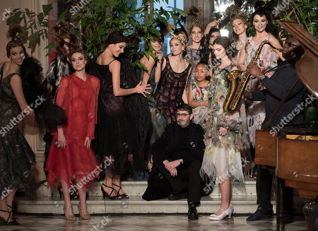 French designer Franck Sorbier (C) waves to the audience following the presentation of his Spring/Summer 2018 Haute Couture collection for Haute couture Sorbier fashion house, in Paris, France, 24 January 2018. Franco-Cameroonian saxophonist and world jazz singer Manu Dibango (R) performed at the show. The presentation of the Haute Couture collections runs from 22 to 25 January.