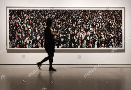 A visitor to the Hayward Gallery looks over Andreas Gursky's artwork 'May Day IV'  2000 remastered 2014 at the newly refurbished Hayward Gallery in London, Britain, 24 January 2018.  The Hayward Gallery will reopen 25 January with its first major UK retrospective of the work of acclaimed German photographer Andreas Gursky. Known for his large-scale, often spectacular pictures that portray emblematic sites and scenes of the global economy and contemporary life, he is widely regarded as one of the most significant photographers of our time.