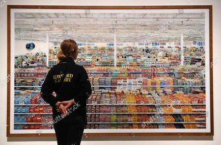A Hayward Gallery staff looks over Andreas Gursky's artwork '99 Cent'  1999 remastered 2009 at the newly refurbished Hayward Gallery in London, Britain, 24 January 2018. The Hayward Gallery will reopen 25 January with its first major UK retrospective of the work of acclaimed German photographer Andreas Gursky. Known for his large-scale, often spectacular pictures that portray emblematic sites and scenes of the global economy and contemporary life, he is widely regarded as one of the most significant photographers of our time.