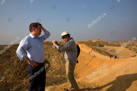 UNICEF Deputy Executive Director Justin Forsyth, left, looks at one of the sprawling Balukhali Rohingya refugee's camp, 50 kilometres (32 miles) from, Cox's Bazar, Bangladesh . Forsyth is on a two day visit to Cox's Bazar to see, first-hand, the devastating humanitarian situation of the Rohingya refugees